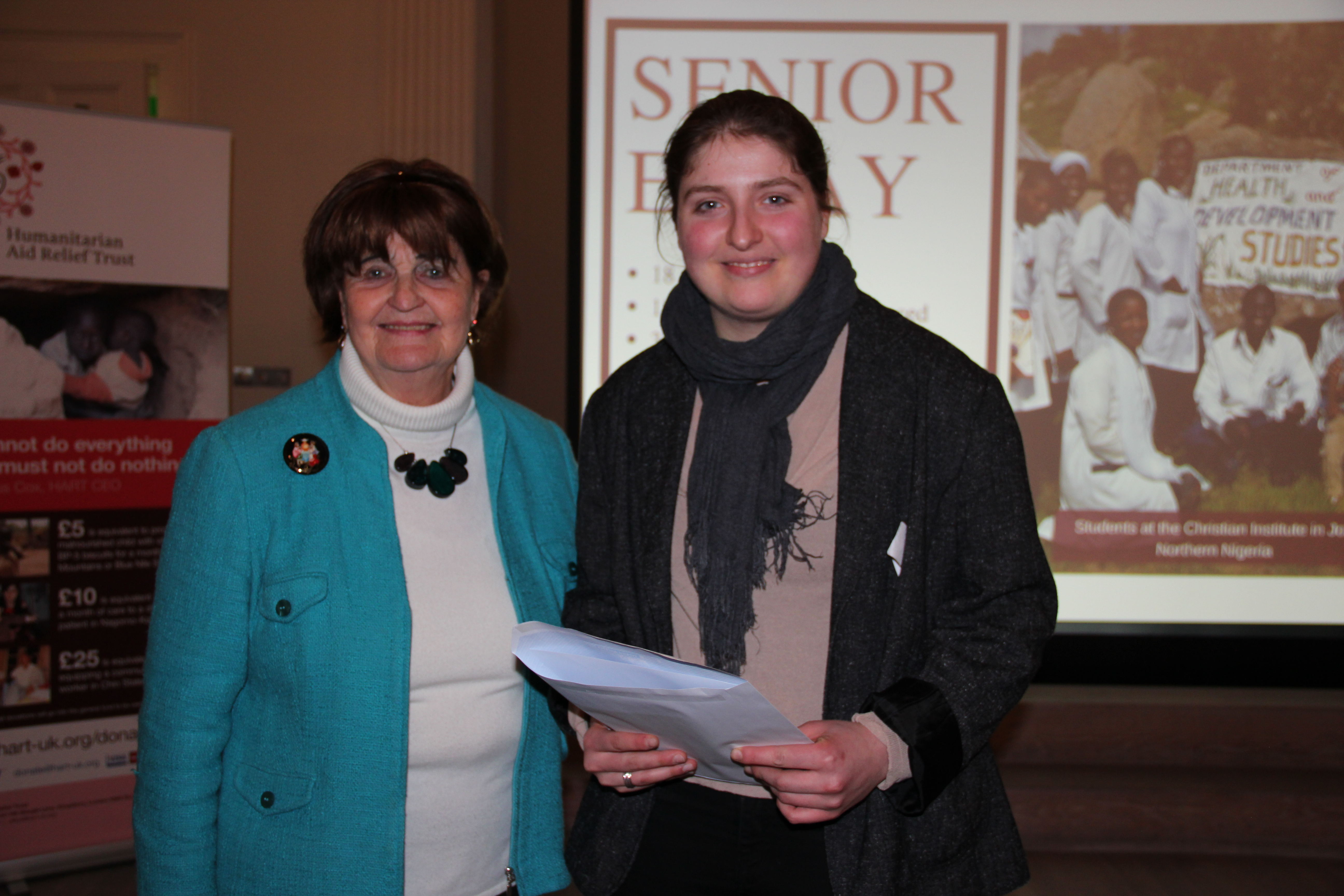 Joint 2nd Prize Senior Essay Winner, Maya Muller collecting her prize